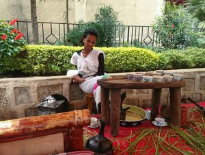 "In the Gotera compound, girls in traditional ""Habesha"" dress spend hours slowly preparing coffee."